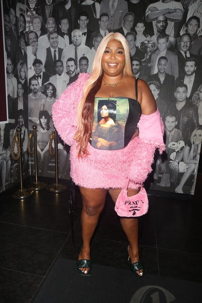 Lizzo with a pink furry Prada bag in June 2021.
