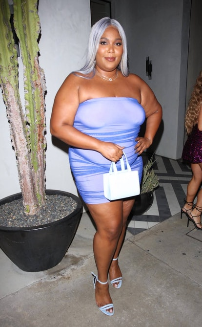 Lizzo wearing CISE's Protect Black People bag in May 2021.
