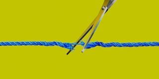 Scissors cutting through string