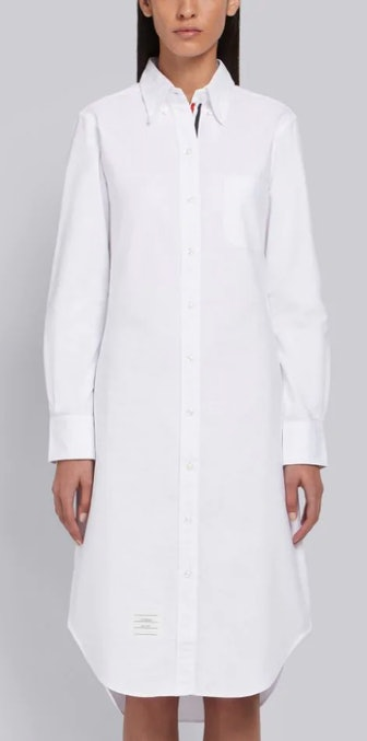 A white knee-length shirt dress with Thom Browne's logo stitching at the neck.