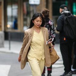 woman wearing yellow vest and matching pants