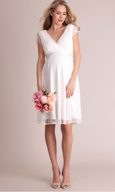 pregnant woman in white maternity dress
