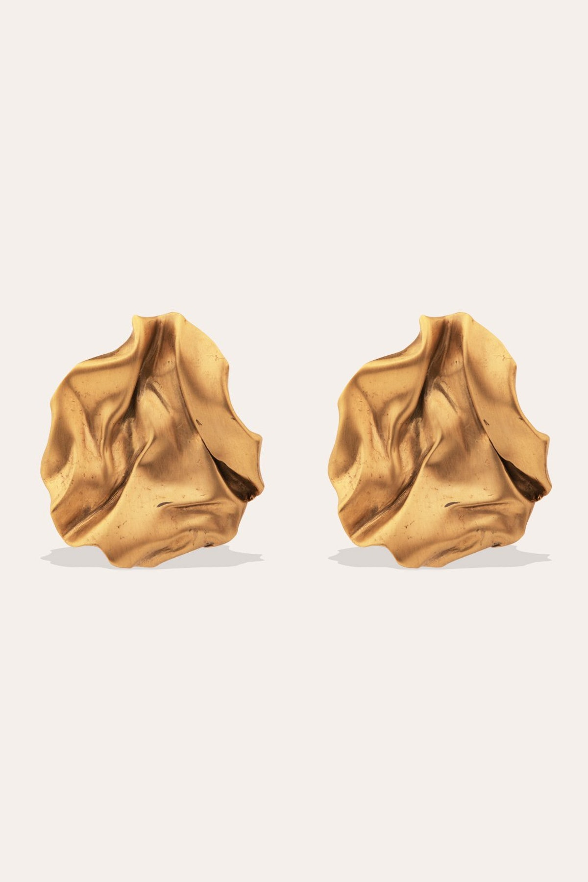 Gold vermeil Groundswell earrings from Completedworks.