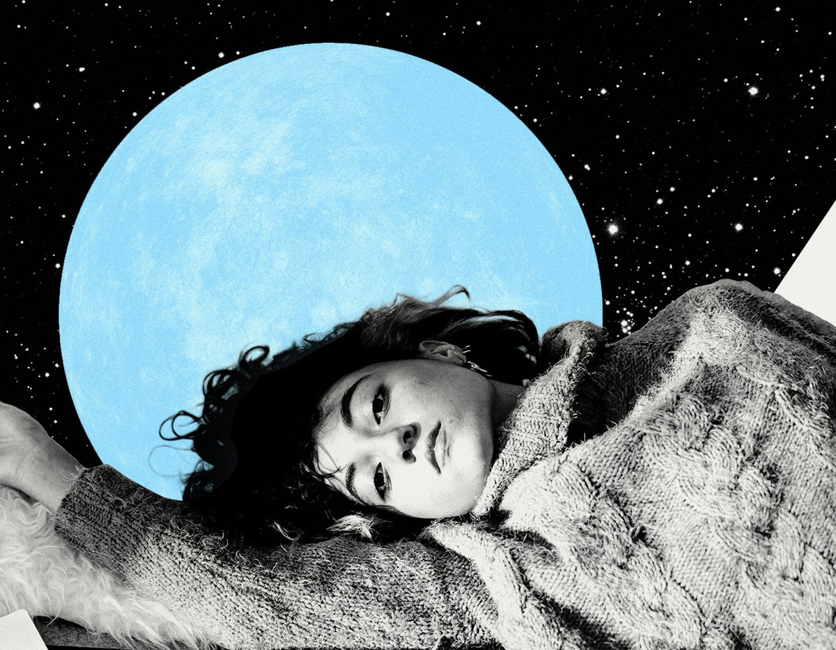 Young woman laying down with the blue moon behind her to show how the July 2021 full moon in Aquarius will affect her zodiac sign the least.