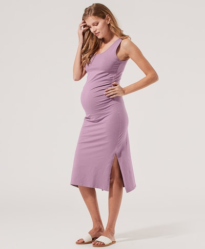 a purple midi maternity dress made in organic cotton with ruched side and side slit