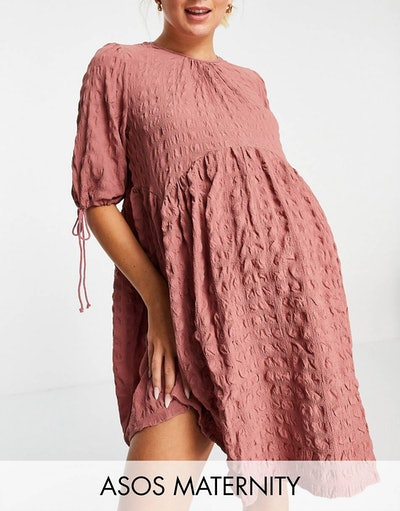 textured pink maternity mini dress with empire waist and ties on the sleeves