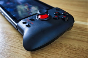 Hori Split Pad Pro review: Controller in translucent black showing analog joystick and ABXY buttons.