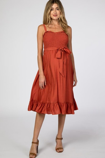 rust colored maternity dress with smocked bodice and ruffle hem
