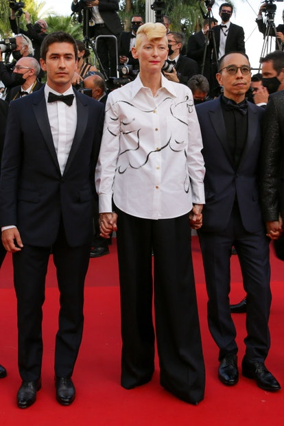"""Juan Pablo Urrego, Tilda Swinton, Apichatpong Weerasethakul attend the final screening of """"OSS 117: From Africa With Love"""" and closing ceremony during the 74th annual Cannes Film Festival on July 17, 2021 in Cannes, France."""