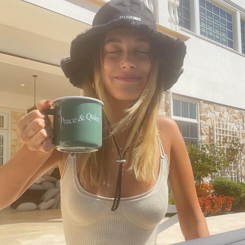Hailey Bieber in a fringed bucket hat.
