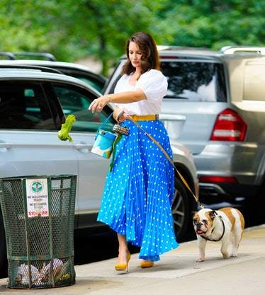 Kristin Davis and a dog on the set of And Just Like That...