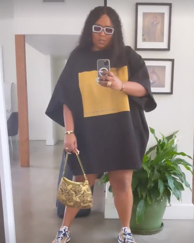 Lizzo is a wearing an oversized T-shirt in July 2021.