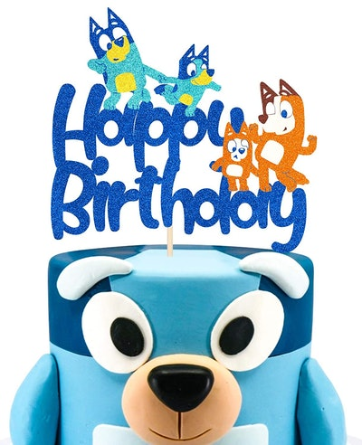 """""""Bluey"""" birthday cake with a cake topper that says """"happy birthday"""" with """"Bluey"""" characters on it"""