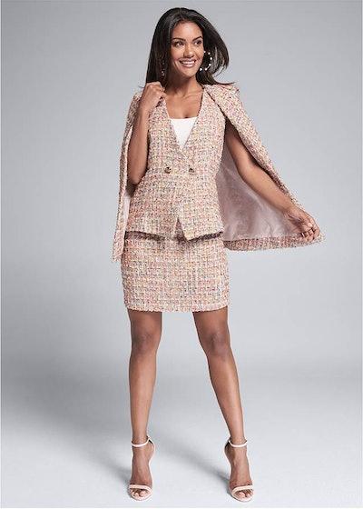 model in pink tweed skirt suit from Venus