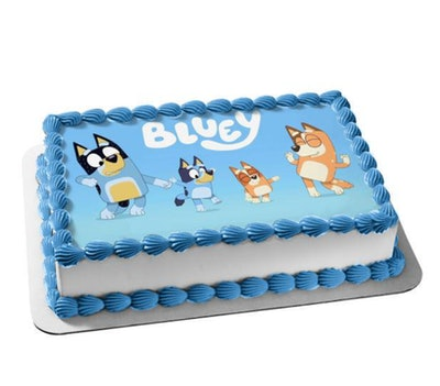 """Birthday cake with overlay featuring characters from the show """"Bluey"""""""