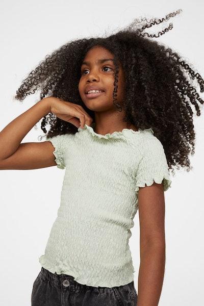 light green smocked shirt for girls, shown on model, from H&M