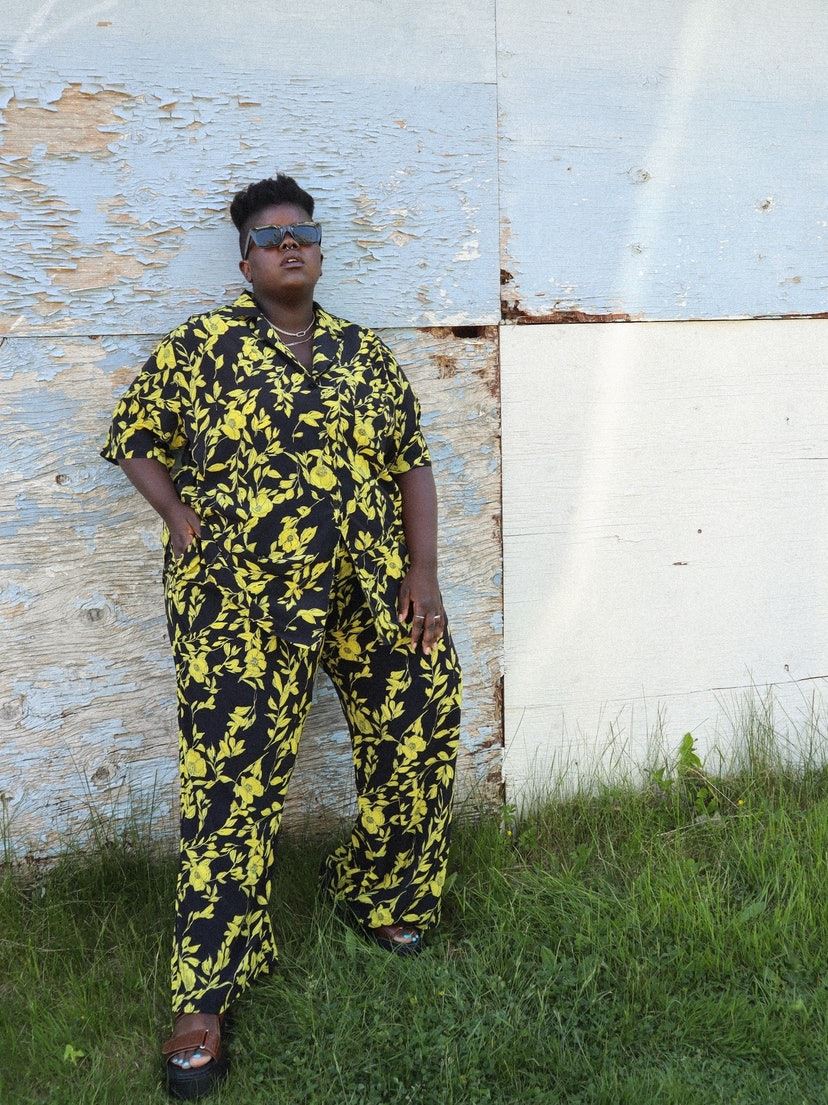Lydia Okello wears a yellow and black, printed two-piece set.