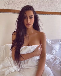 Kim Kardashian in natural makeup and wrapped up in sheets