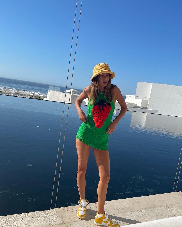 Hailey Bieber in green strawberry dress.