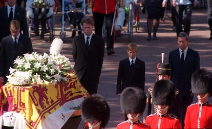 The sons of Diana, Princess of Wales, her brother and her former husband, the Prince of Wales, somberly walk behind her coffin as the funeral procession approaches Westminster Abbey.
