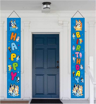 """Front door with a """"Happy"""" banner on one side and """"Birthday"""" banner on the other with """"Bluey"""" charact..."""