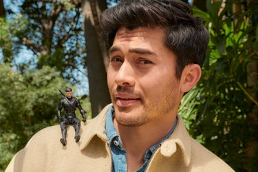 Golding poses with an action figure of himself from Snake Eyes.
