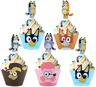 """Five cupcakes with """"Bluey"""" themed wrappers and toppers"""