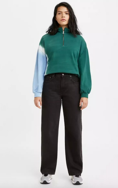 model in levi's loose black jeans and colorblocked pullover