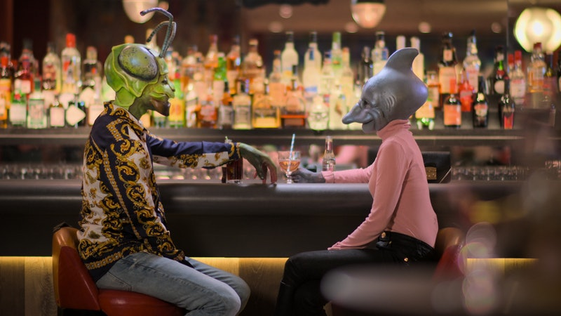 Two contestants from 'Sexy Beasts' on a date, dressed as a praying mantis and a dolphin.