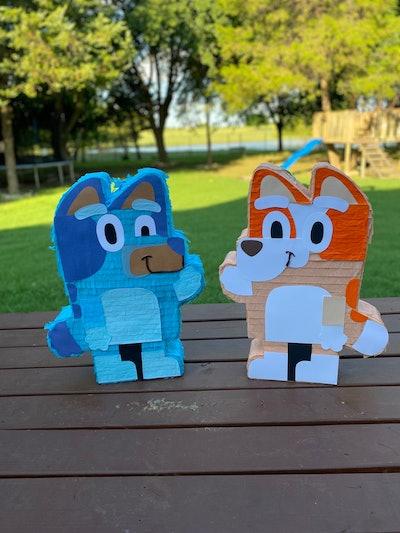 "Pinatas of ""Bluey"" characters Bingo and Bluey"