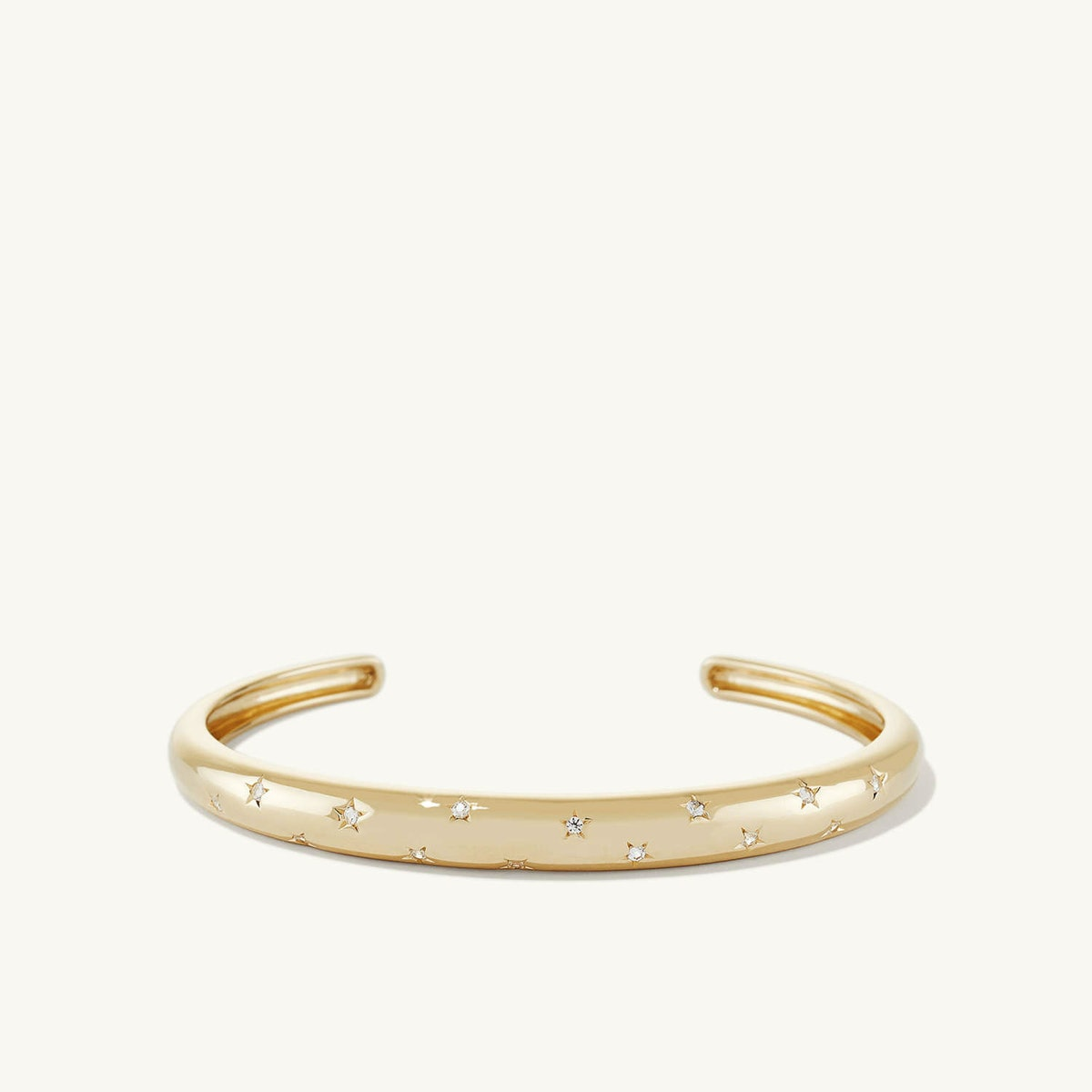 LA Dôme cuff bracelet in gold vermeil with white sapphires from Mejuri.