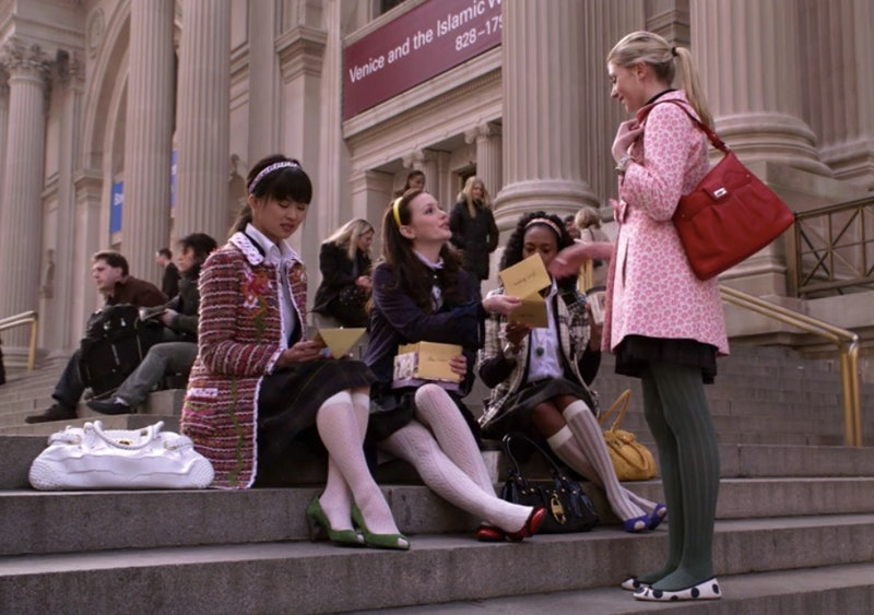 A screenshot from the original Gossip Girl showing Blair Waldorf giving Jenny Humphrey a party invit...