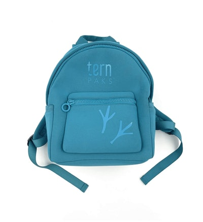 Teal blue backpack with two tree branches in darker shade on the front
