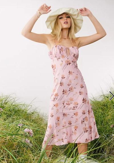 model in hat wearing floral midi slip dress