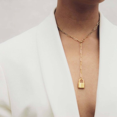 model wear gold paper clip chain necklace with lock charm