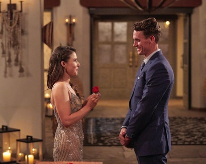 Katie giving Mike a rose during a Rose Ceremony.