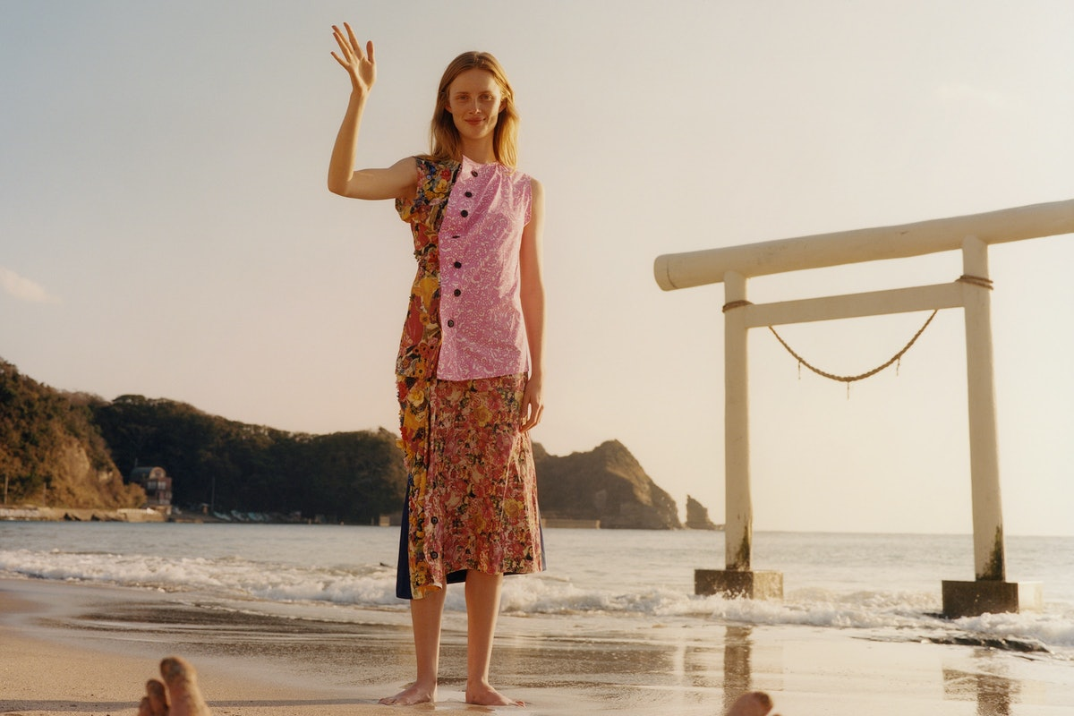 The model Rianne van Rompaey wearing a colorful outfit on a beach in Japan