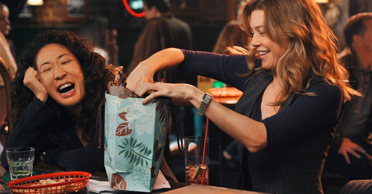 Cristina Yang (Sandra Oh) laughing with her person Meredith Grey (Ellen Pompeo) on 'Grey's Anatomy'.