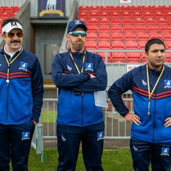 Coach Ted, Beard, and Nate all look on at a practice in 'Ted Lasso' Season 2