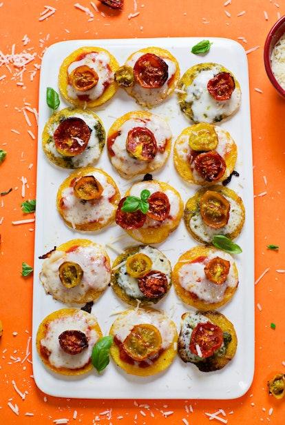 mini polenta pizzas topped with cherry tomatoes
