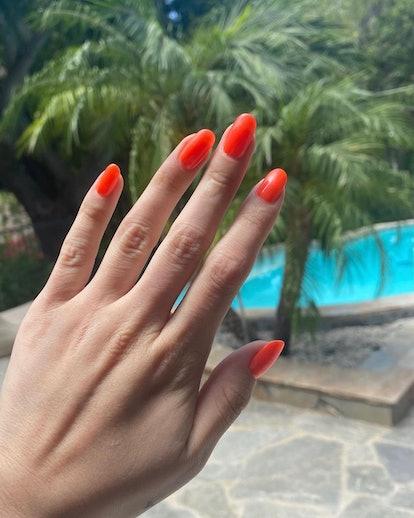 Selena Gomez's red-orange nails by Tom Bachik