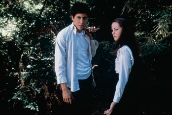 Jake Gyllenhaal and Jena Malone stand next to each other in Donnie Darko