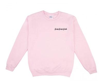 "pink sweatshirt featuring the phrase ""girls girls girls"""