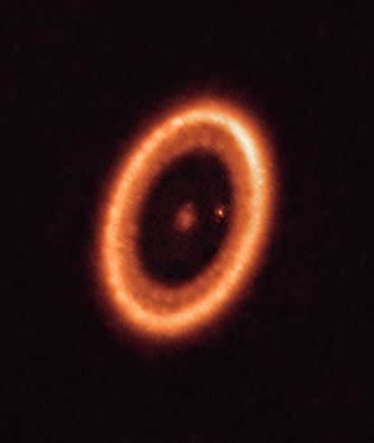 A red-orange disc circles the sun PDS 70 and two planets.