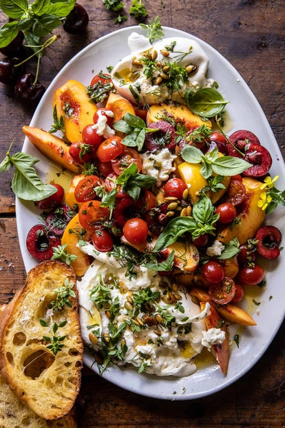 tomato beach and burrata salad, shot from above, served with bread