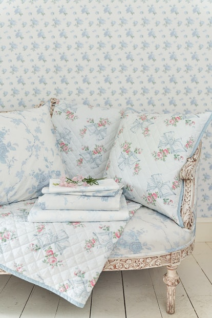LoveShackFancy's new wallpaper and bedding includes whimsical blue and pink prints