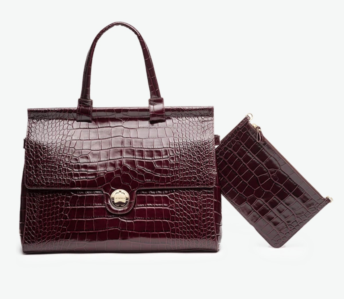 JEMMa's crocodile bordeaux traveler tote that has a section for your laptop.