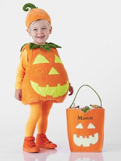 Child in a pumpkin costume