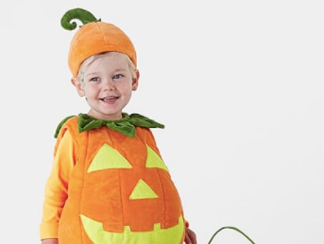 a toddler wearing a Pumpkin Halloween costume