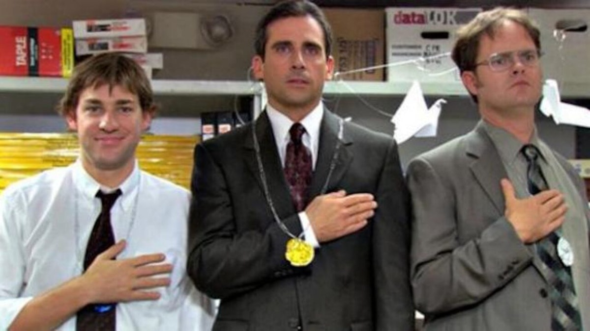 Jim Halpert, Michael Scott, and Dwight Schrute stand on podiums for 'The Office' Olympics episode.